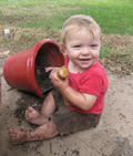 This child is having a great time getting dirty.